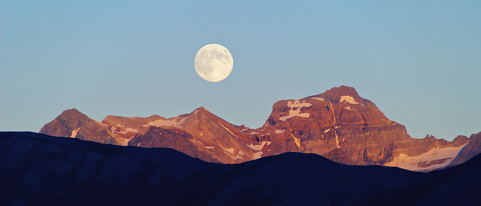 Photo of moon and mountains
